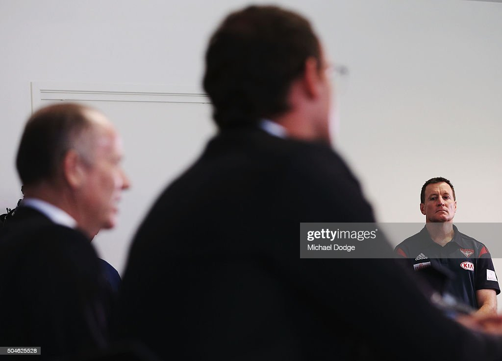 Essendon Bombers coach John Worsfold listens to Bombers CEO Xavier Campbell and Chairman Lindsay Tanner speak to media at a press conference at the...