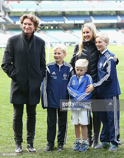 Essendon Bombers head coach James Hird and his wife Tania Hird are seen with their children during a Real Madrid training session at Melbourne...