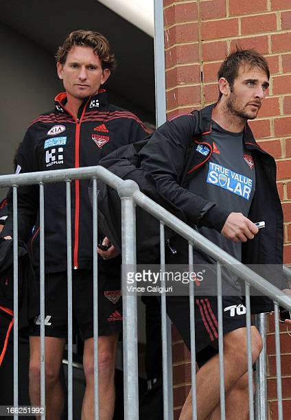 Essendon Coach James Hird and captain Jobe Watson leave a Windy Hill training session to head to Melbourne Airport for the teams flight to Perth on...