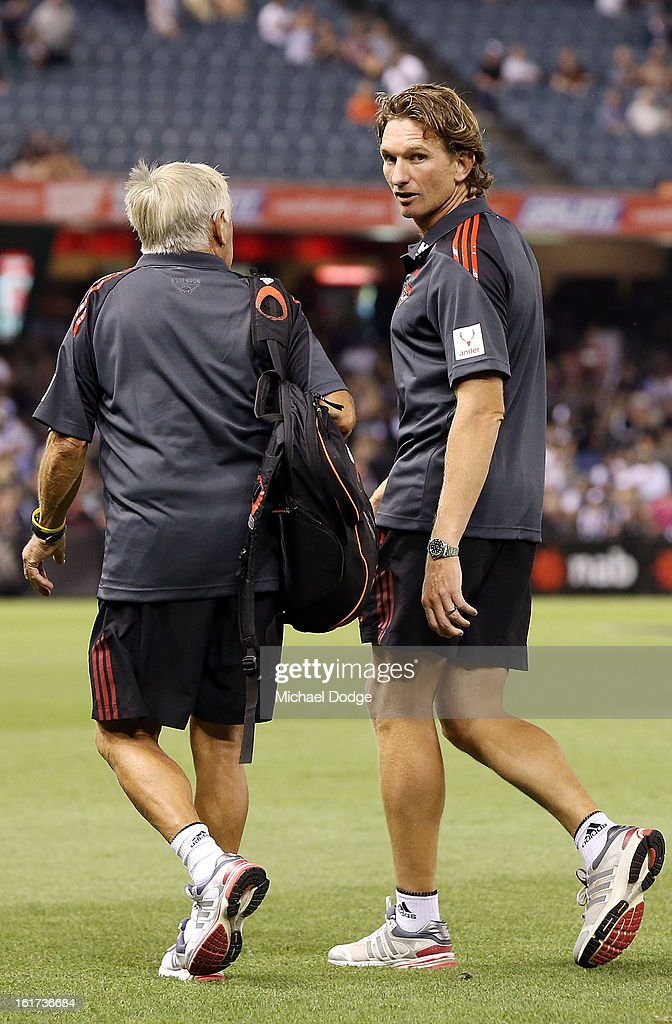 Essendon coach <a gi-track='captionPersonalityLinkClicked' href=/galleries/search?phrase=James+Hird&family=editorial&specificpeople=201975 ng-click='$event.stopPropagation()'>James Hird</a> walks onto the field for the round one AFL NAB Cup match between the Collingwood Magpies and the Essendon Bombers at Etihad Stadium on February 15, 2013 in Melbourne, Australia.
