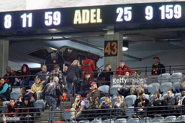 Essendon fans walk out as the margin hits 100 points during the round 20 AFL match between the Essendon Bombers and the Adelaide Crows at Etihad...