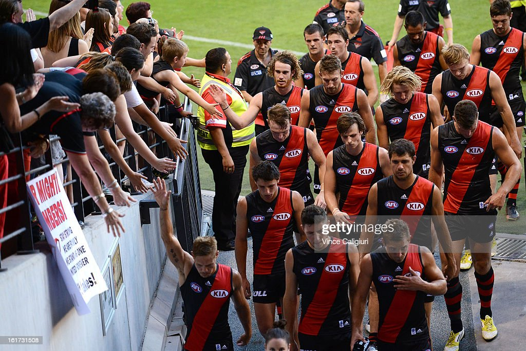 Essendon players leave the ground after defeating the bulldogs in the round one AFL NAB Cup match between the Essendon Bombers and the Western Bulldogs at Etihad Stadium on February 15, 2013 in Melbourne, Australia.
