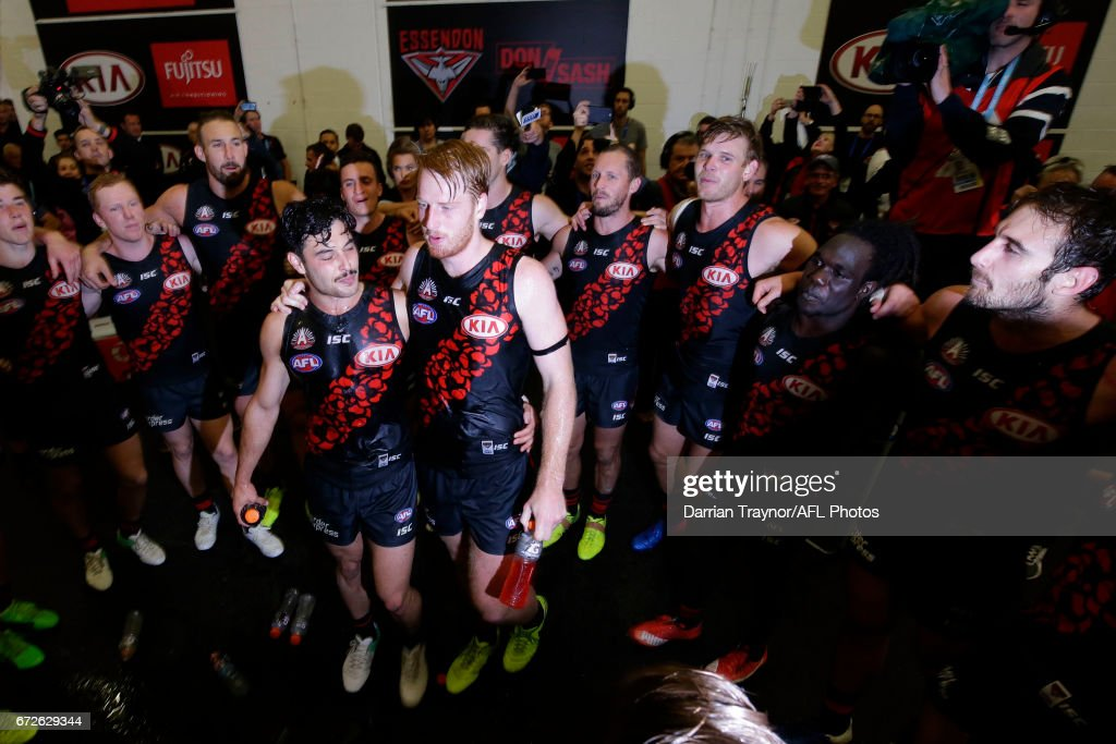 Essendon players sing the team song after the round five AFL match between the Essendon Bombers and the Collingwood Magpies at Melbourne Cricket Ground on April 25, 2017 in Melbourne, Australia.