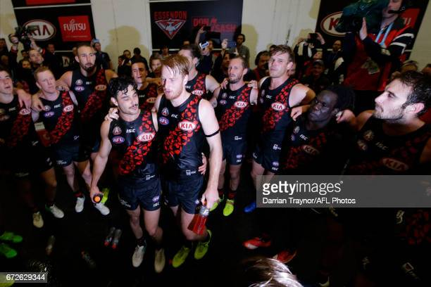 Essendon players sing the team song after the round five AFL match between the Essendon Bombers and the Collingwood Magpies at Melbourne Cricket...