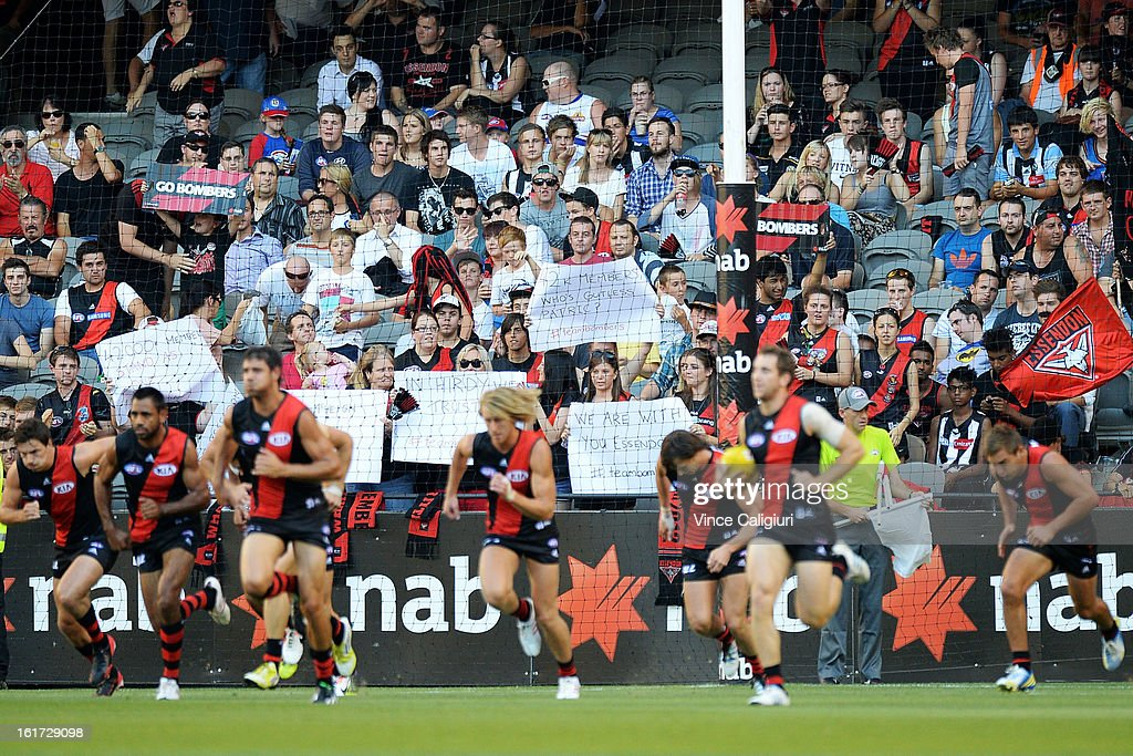 Essendon supporters hold up signs to show their support during the round one AFL NAB Cup match between the Essendon Bombers and the Western Bulldogs at Etihad Stadium on February 15, 2013 in Melbourne, Australia.