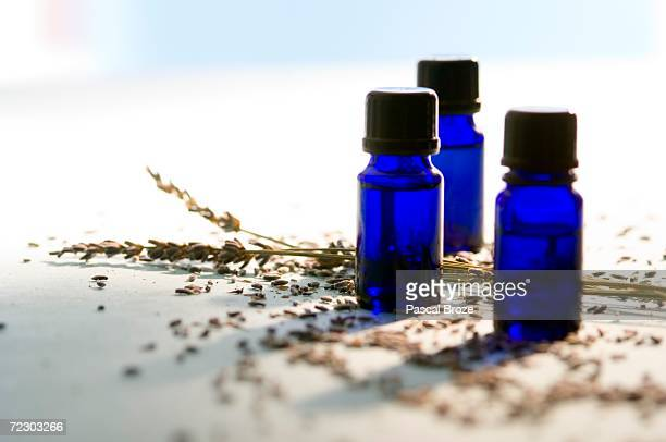 3 essential oil bottles, close-up