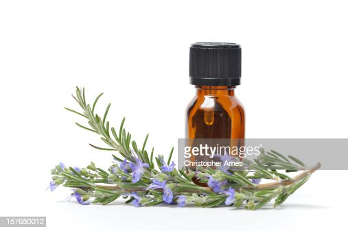 Essential Oil with Sprigs of Fresh Rosemary