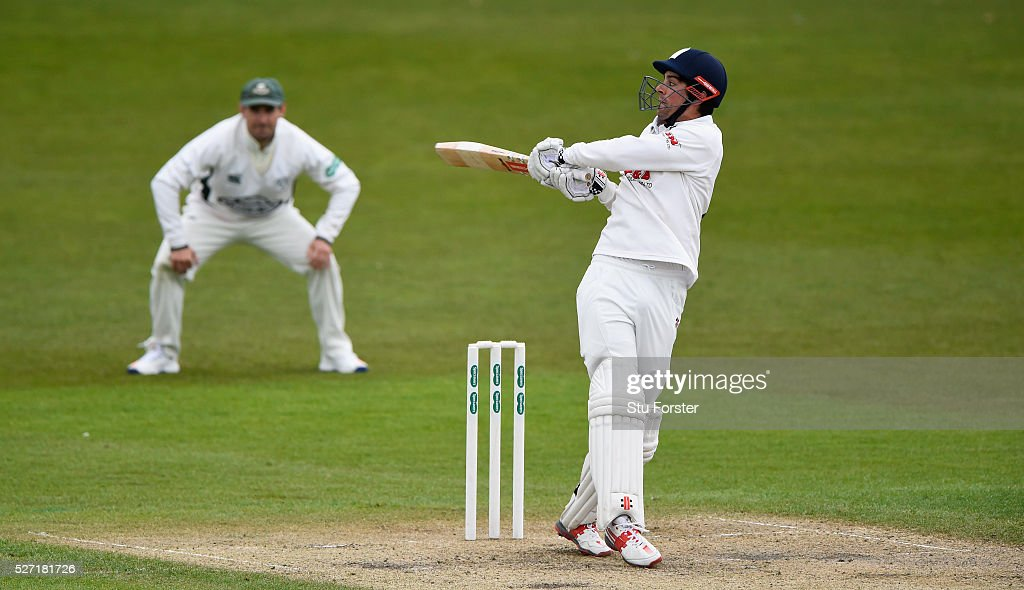 Esses batsman <a gi-track='captionPersonalityLinkClicked' href=/galleries/search?phrase=Alastair+Cook+-+Cricket+Player&family=editorial&specificpeople=571475 ng-click='$event.stopPropagation()'>Alastair Cook</a> pulls a ball to the boundary watched by Daryl Mitchell during day two of the Specsavers County Championship Division Two match between Worcestershire and Essex at New Road on May 2, 2016 in Worcester, England.