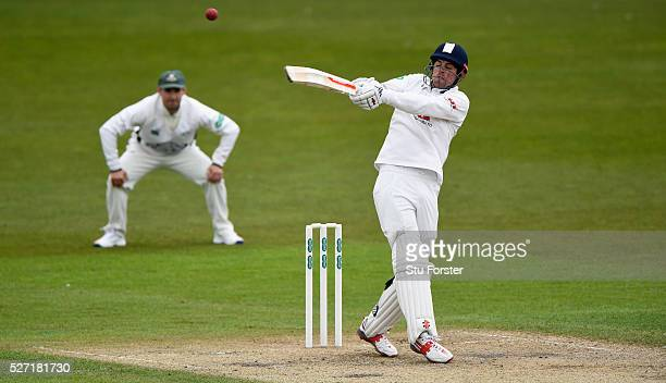 Esses batsman Alastair Cook pulls a ball to the boundary watched by Daryl Mitchell during day two of the Specsavers County Championship Division Two...