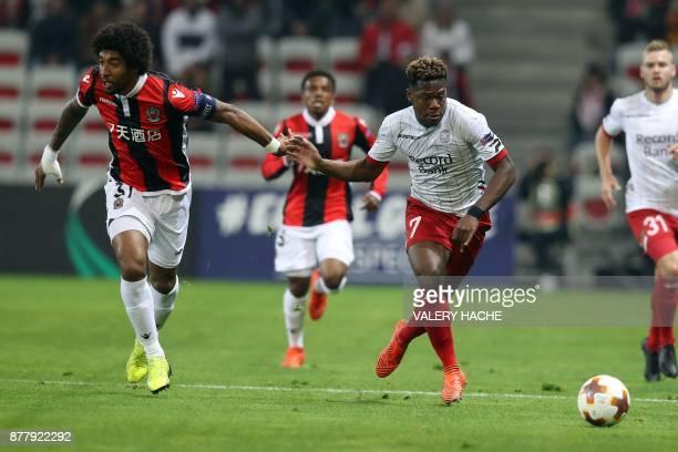 Essevee's Aaron Leya Iseka vies with Nice's Brazilian defender Dante during the UEFA Europa League football match between OGC Nice vs Zulte Waregem...