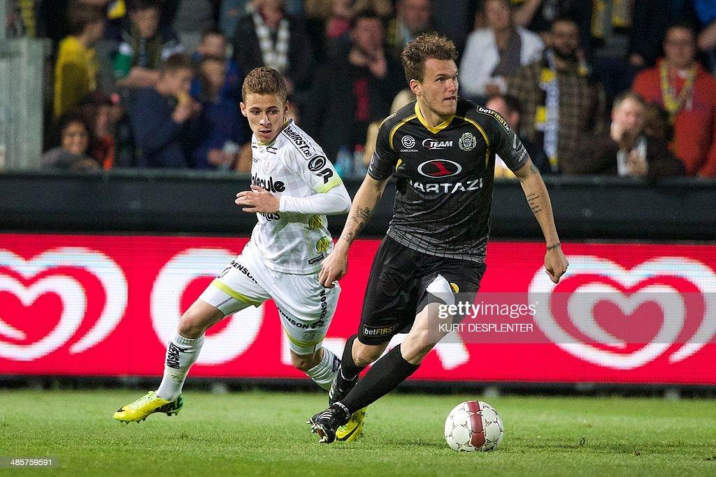 Essevee's Thorgan Hazard vies for the ball Lokeren's Alexander Scholz during the Belgian Jupiler Pro League match between Sporting Lokeren and SV...
