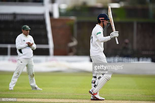 Essex batsman Alastair Cook reaches his century as Daryl Mitchell applauds during day two of the Specsavers County Championship Division Two match...