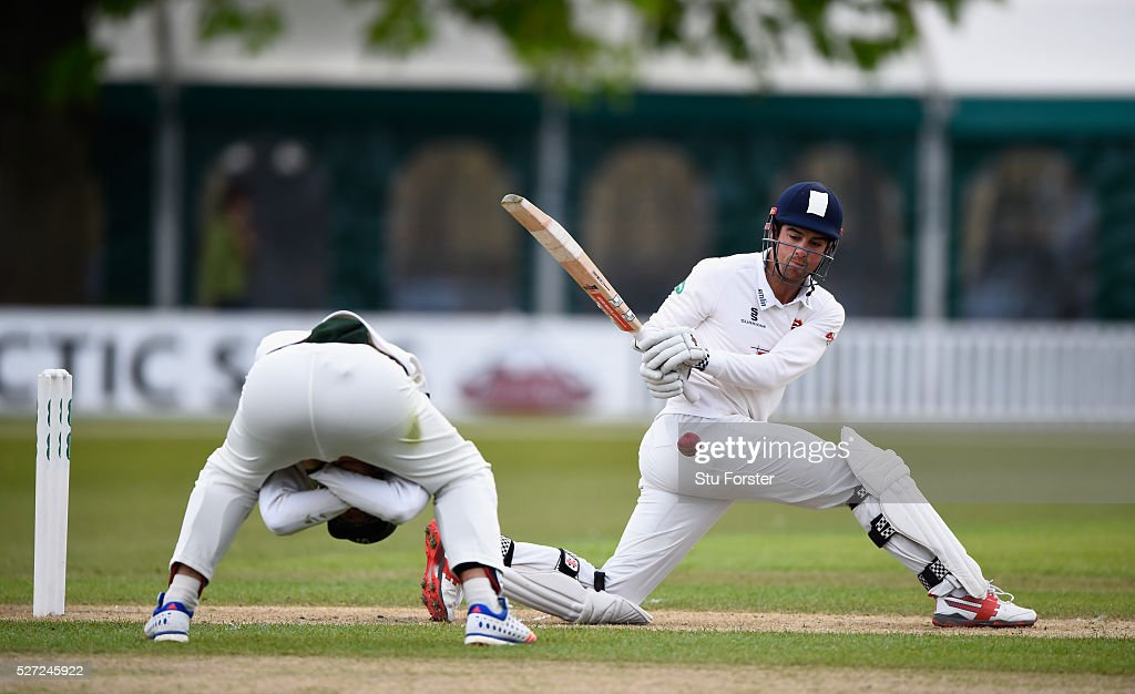 Essex batsman Alastair Cook sweeps towards the boundary as fielder Ross Whiteley takes evasive action during day two of the Specsavers County...