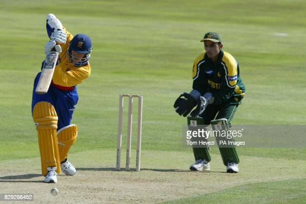 Essex batsman Andy Flower hits his 50th run off Pakistan's Mohammad Hafeez during the one day tour match at the County Ground Chelmsford
