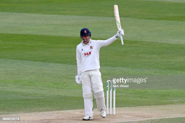 Essex batsman Dan Lawrence raises his bat having scored a century of runs at Cloudfm County Ground on April 10 2017 in Chelmsford England