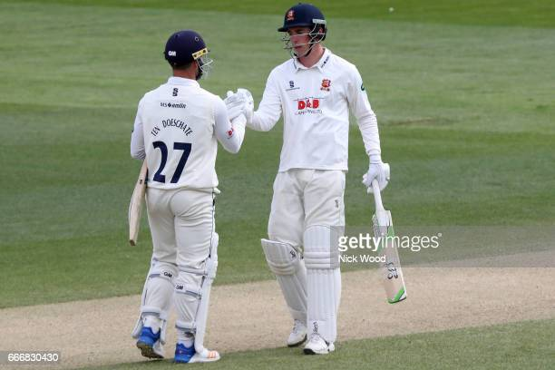 Essex batsman Daniel Lawrence receives a handshake from captain Ryan ten Doeschate having scored a century of runs at the Cloudfm County Ground on...