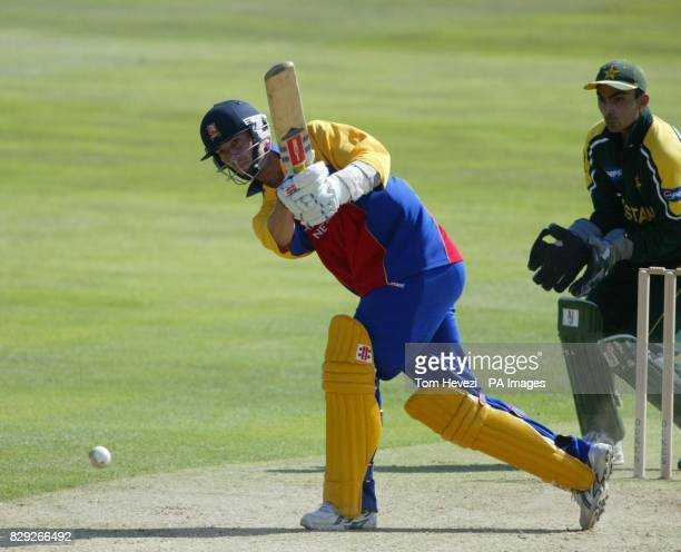 Essex batsman James Foster drives a ball from Pakistan Muhammad Hafeez during the one day tour match at the County Ground Chelmsford
