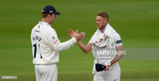Essex bowler Jamie Porter is congratulated by Simon Harmer after taking his fifth wicket of the innings during day three of the Specsavers County...