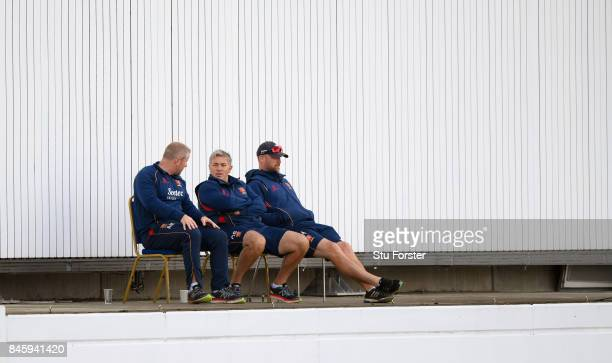 Essex coach Chris Silverwood and his staff watch proceedings during day one of the Specsavers County Championship Division One match between...