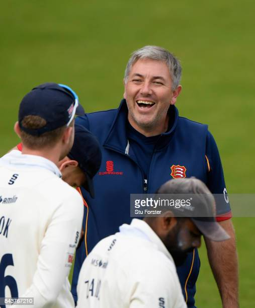 Essex coach Chris Silverwood shares a joke with his players before day three of the Specsavers County Championship Division One match between...