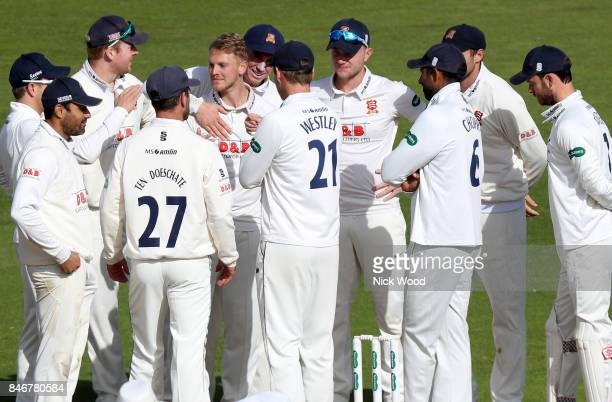Essex players celebrate taking the wicket of Sam Hain during the Warwickshire v Essex Specsavers County Championship Division One cricket match at...
