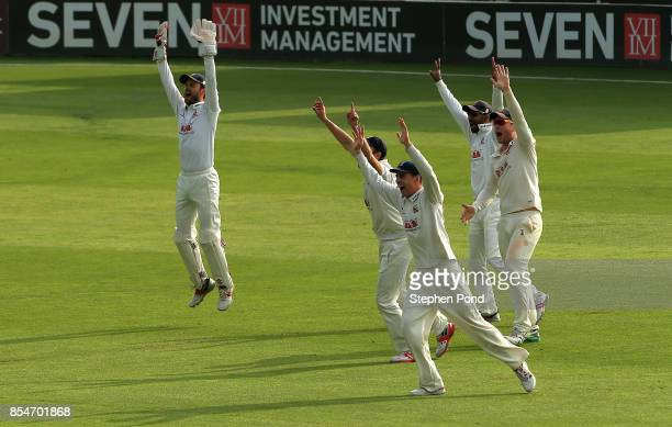 Essex players celebrates the wicket of Gary Ballance of Yorkshire during day three of the Specsavers County Championship Division One match between...