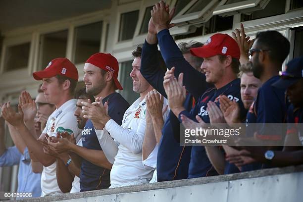 Essex team watch from the pavilion as they celebrate Ryan ten Doeschate century on his way to helping the team win promotion during the Specsavers...