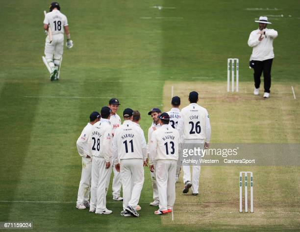 Essex's Aaron Beard celebrates with teammates after taking the wicket of Middlesex's Nick Gubbins caught behind by Adam Wheater for 101 on day 1 of...