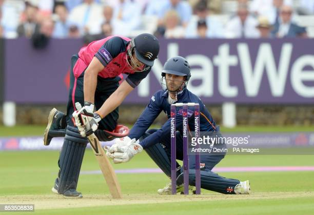 Essex's James Foster lookson as Middlesex's Dawid Malan loses his footing during the Natwest T20 Blast South Division match at Lord's Cricket Ground...
