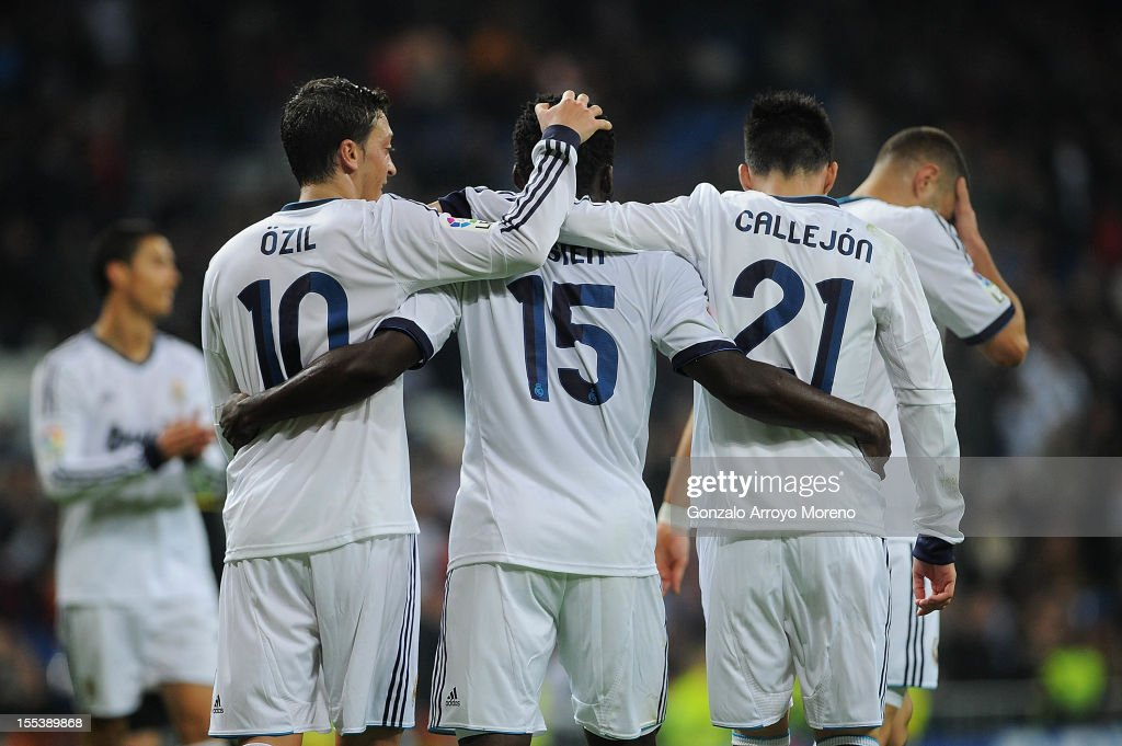 Essien of Real Madrid CF celebrates scoring their third goal with teammate Mezut Ozil (L), <a gi-track='captionPersonalityLinkClicked' href=/galleries/search?phrase=Jose+Maria+Callejon&family=editorial&specificpeople=6671079 ng-click='$event.stopPropagation()'>Jose Maria Callejon</a> (2ndR) and <a gi-track='captionPersonalityLinkClicked' href=/galleries/search?phrase=Karim+Benzema&family=editorial&specificpeople=796089 ng-click='$event.stopPropagation()'>Karim Benzema</a> (R) during the La Liga match between Real Madrid CF and Real Zaragoza at Estadio Santiago Bernabeu on November 3, 2012 in Madrid, Spain.