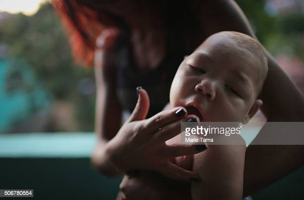 Estafany Perreira holds her nephew David Henrique Ferreira 5 months who has microcephaly on January 25 2016 in Recife Brazil In the last four months...