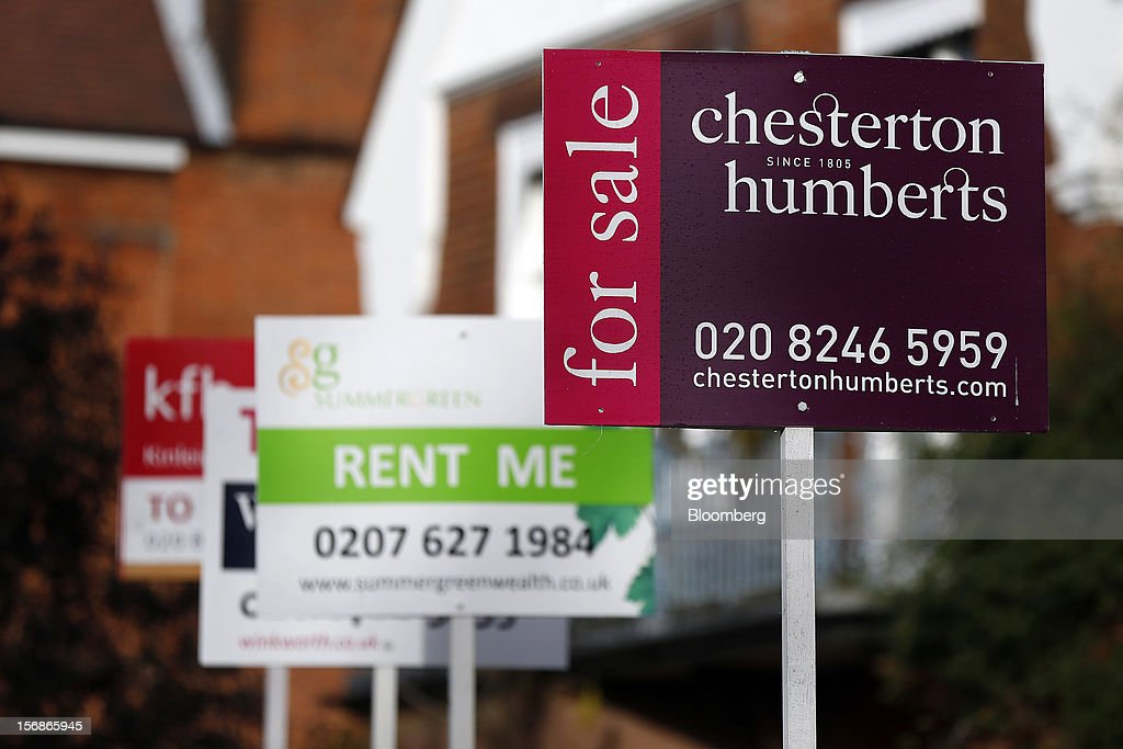 Estate agent signs advertising properties 'To Let' and ''For Sale' stand outside residential buildings in the Roehampton district of London, U.K., on Friday, Nov. 23, 2012. U.K. mortgage approvals rose to a nine-month high in October, the British Bankers' Association said. Photographer: Simon Dawson/Bloomberg via Getty Images
