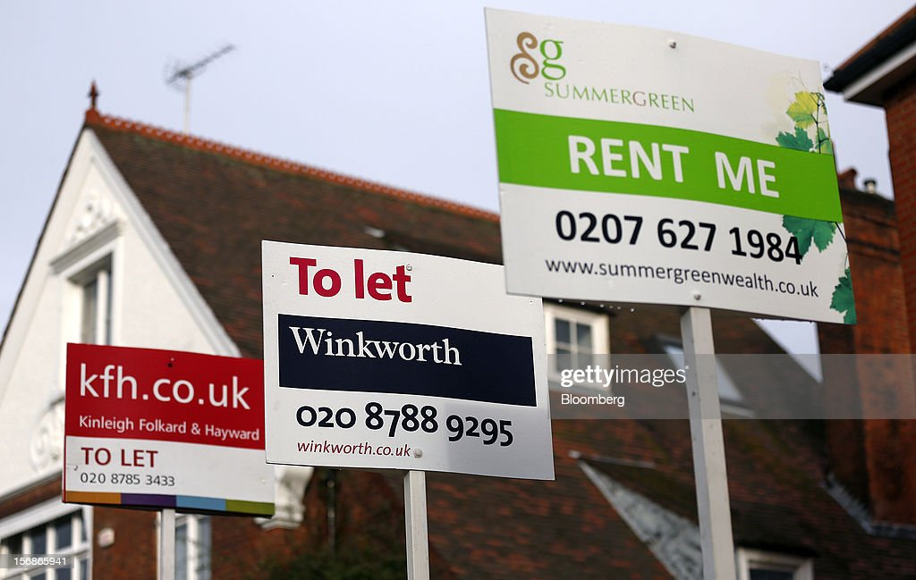Estate agent signs advertising properties 'To Let' and ''Rent Me' stand outside residential buildings in the Roehampton district of London, U.K., on Friday, Nov. 23, 2012. U.K. mortgage approvals rose to a nine-month high in October, the British Bankers' Association said. Photographer: Simon Dawson/Bloomberg via Getty Images