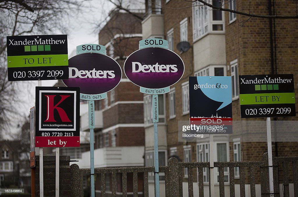 Estate agent signs advertising residential property ''To Let'', ''Let By' and 'Sold', stand outside a block of residential apartments in the Clapham district of London, U.K., on Friday, Feb. 22, 2013. U.K. home sellers raised their asking prices to the most for a February in five years as inquiries from potential buyers increased, Rightmove Plc said. Photographer: Simon Dawson/Bloomberg via Getty Images