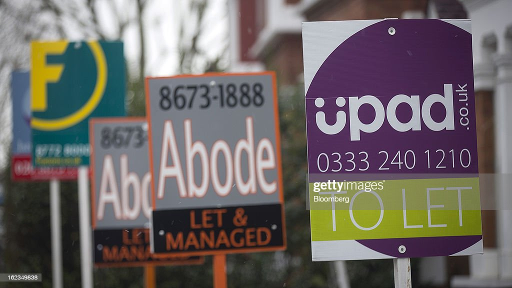 Estate agent signs advertising residential property ''To Let'', ''Let By'', are seen in the Clapham district of London, U.K., on Friday, Feb. 22, 2013. U.K. home sellers raised their asking prices to the most for a February in five years as inquiries from potential buyers increased, Rightmove Plc said. Photographer: Simon Dawson/Bloomberg via Getty Images