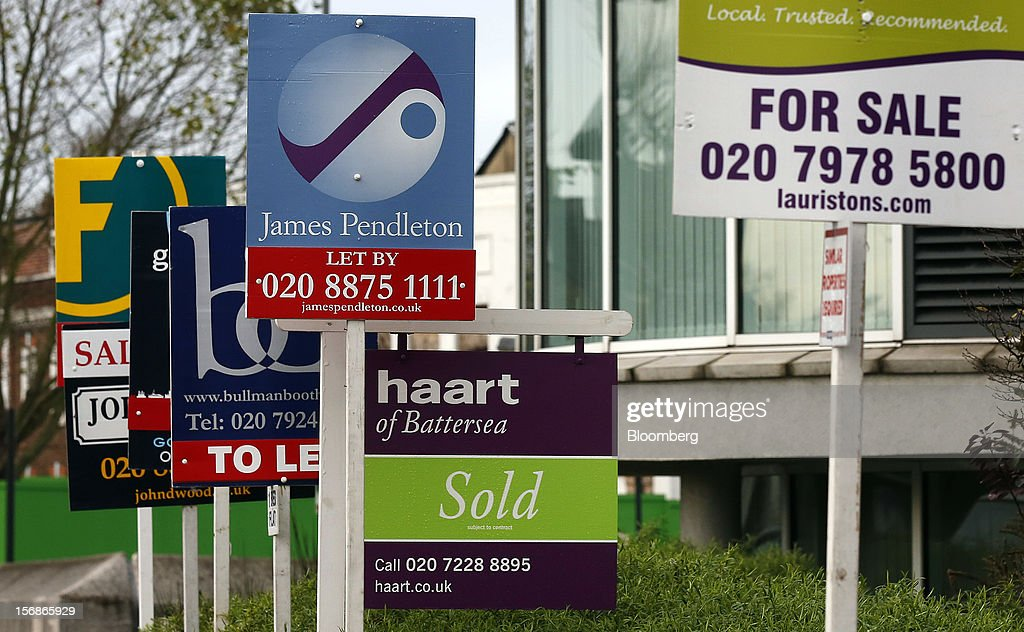 Estate agent signs advertising residential property ''To Let'', ''Let By'', 'For Sale', and ''Sold'' are seen in the Wandsworth district of London, U.K., on Friday, Nov. 23, 2012. U.K. mortgage approvals rose to a nine-month high in October, the British Bankers' Association said. Photographer: Simon Dawson/Bloomberg via Getty Images