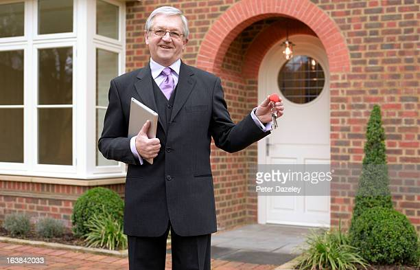 Estate agent with keys to new house
