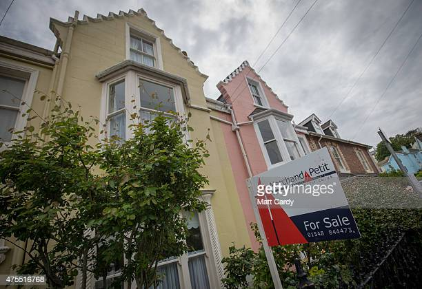 A estate agents for sale board is displayed outside a property in the seaside town of Salcombe on June 1 2015 in Devon England In a recent study by...