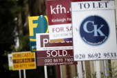 Estate agents' 'For Sale' 'To Let' and 'Sold' signs stand outside a row of terraced houses and apartments in London UK on Tuesday July 1 2014 Bank of...