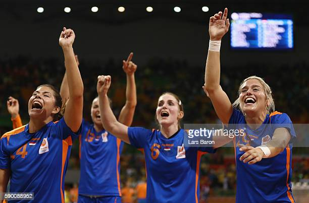 Estavana Polman of Netherlands celebrates with her team mates after winning the Womens Quarterfinal match between Brazil and Netherlands on Day 11 of...