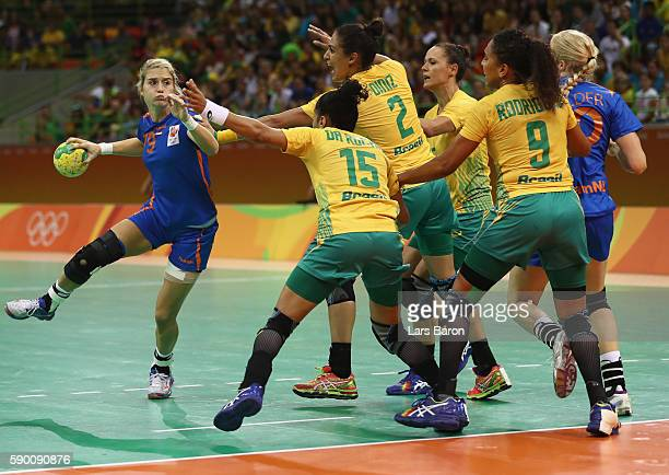 Estavana Polman of Netherlands is challenged by four players of Brazil during the Womens Quarterfinal match between Brazil and Netherlands on Day 11...