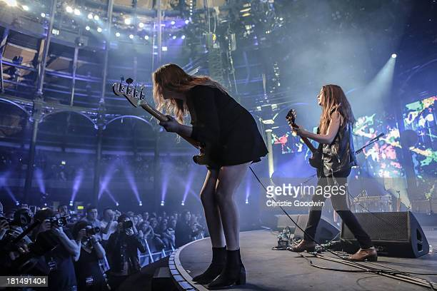 Este Haim and Danielle Haim of HAIM perform on stage on Day 21 of iTunes Festival 2013 at The Roundhouse on September 21 2013 in London England