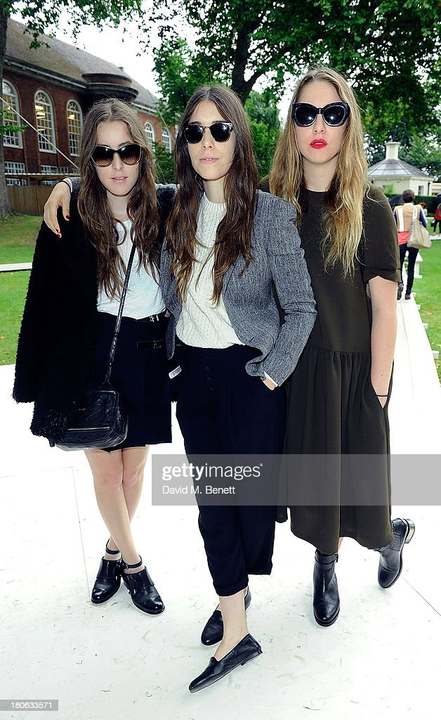 <a gi-track='captionPersonalityLinkClicked' href=/galleries/search?phrase=Este+Haim&family=editorial&specificpeople=2499486 ng-click='$event.stopPropagation()'>Este Haim</a>, <a gi-track='captionPersonalityLinkClicked' href=/galleries/search?phrase=Danielle+Haim&family=editorial&specificpeople=2499485 ng-click='$event.stopPropagation()'>Danielle Haim</a>, <a gi-track='captionPersonalityLinkClicked' href=/galleries/search?phrase=Alana+Haim&family=editorial&specificpeople=9431818 ng-click='$event.stopPropagation()'>Alana Haim</a> of Haim attends the Unique SS14 runway show during London Fashion Week on September 15, 2013 in London, England.