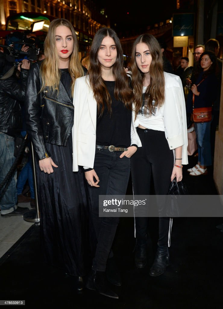 <a gi-track='captionPersonalityLinkClicked' href=/galleries/search?phrase=Este+Haim&family=editorial&specificpeople=2499486 ng-click='$event.stopPropagation()'>Este Haim</a>, <a gi-track='captionPersonalityLinkClicked' href=/galleries/search?phrase=Danielle+Haim&family=editorial&specificpeople=2499485 ng-click='$event.stopPropagation()'>Danielle Haim</a> and <a gi-track='captionPersonalityLinkClicked' href=/galleries/search?phrase=Alana+Haim&family=editorial&specificpeople=9431818 ng-click='$event.stopPropagation()'>Alana Haim</a> from rock band Haim attend the Karl Lagerfeld flagship store opening at Regent Street on March 13, 2014 in London, England.