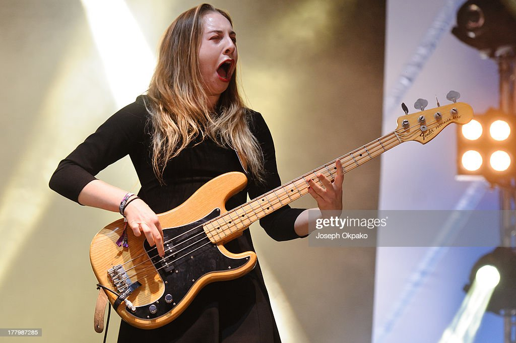 <a gi-track='captionPersonalityLinkClicked' href=/galleries/search?phrase=Este+Haim&family=editorial&specificpeople=2499486 ng-click='$event.stopPropagation()'>Este Haim</a> of Haim performs on stage on Day 3 of Reading Festival 2013 at Richfield Avenue on August 25, 2013 in Reading, England.