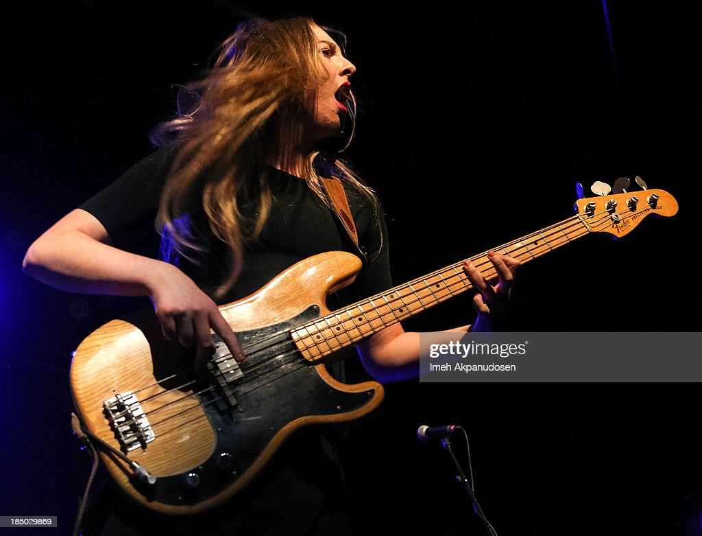 Este Haim of HAIM performs onstage at The Fonda Theatre on October 16 2013 in Los Angeles California
