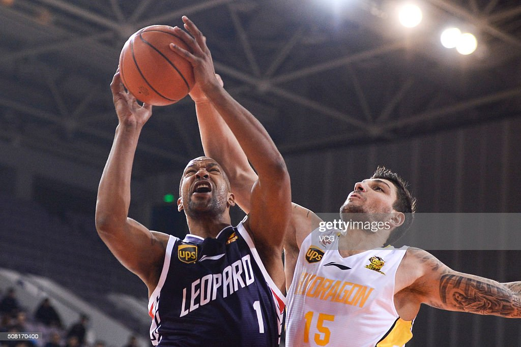 Esteban Batista of Beikong Fly Dragons defends against Dominic McGuire of Shenzhen Leopard during the 37th round of the Chinese Basketball...