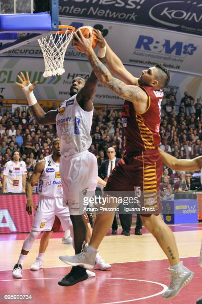 Esteban Batista of Umana competes with Dustin Hogue of Dolomiti during the match game 2 of play off final series of LBA Legabasket of Serie A1...