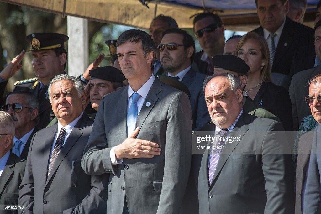 Esteban Bulrich Minister of Education and Ricardo Colombo Governor of Corrientes sing the national anthem during a ceremony to honor General Jose de...