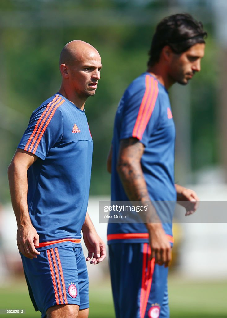 <a gi-track='captionPersonalityLinkClicked' href=/galleries/search?phrase=Esteban+Cambiasso&family=editorial&specificpeople=213561 ng-click='$event.stopPropagation()'>Esteban Cambiasso</a> (L) and Alejandro Dominguez attend a Olympiacos FC training session ahead of their UEFA Champions League Group F match against Bayern Muenchen at Olympiacos training ground on September 15, 2015 in Athens, Greece.